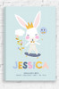 Australian made and designed wall art canvas for a little girl with personalised birth details at the bottom. The canvas features a rabbit with long ears, wearing a colourful jumpsuit and riding a blue skateboard with gold wheels. The design uses pastel colours and has the personlised name and birth details at the bottom.