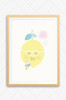 A wall art poster frame in oak finish featuring a happy lemon. The lemon wears a pair of white glasses and can be seen licking a striped ice-block under a smiling sun. The colours are bright pastel tones with a Scandinavian design style.