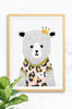 A framed poster of a cute bear who wears a pale pink leopard print t-shirt with gold trim, and a small gold crown on her head. The body of the bear is hand illustrated with fine detail on the fur.