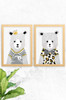 An image showing Luca Rose Designs 2 pack of Bear prints, named Noah and Ted. Both wear bold t-shirts, one with black and white stripes, the other with a striped bow tie and leopard print. Framed in an oak finish timber and mounted on a concrete wall. Illustrated and printed in Australia.