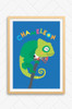 An brightly illustrated poster print featuring a green chameleon on a bright blue background. The word Chameleon is written above the animal in a fun off centred font. Mounted on a wall and framed in an oak frame.