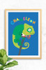 A cute print for a child's bedroom featuring a bold green chameleon hanging on a branch. The word Chameleon is arranged above his head in a colourful type, contrasting with a cobalt background.