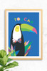A toucan wall art illustration perfect for any little animal enthusiast! A happy bird with a colourful beak and patterned bow tie, nestled amongst some luscious leaves.