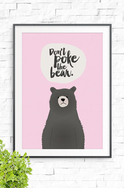A pink background with a brown bear in the foreground and the words 'Don't Poke The Bear' written above. His face has a grumpy expression.