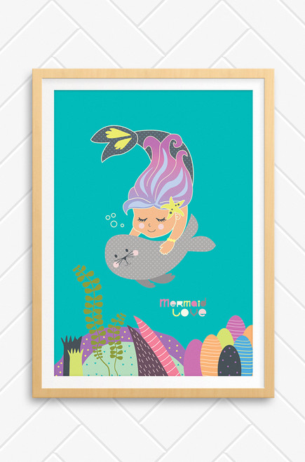 Mermaid Love illustrated wall art poster for kids with swimming mermaid holding a small, cute seal.Below is a colorful seabed of coral and seaweed, all on an aqua background.