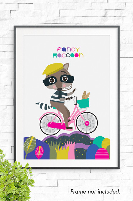 An illustration of a racoon riding a pink bike across a colorful landscape of round shapes. Dressed in a mustard colored French buret and a black and white striped jumper. The words 'Fancy Racoon' are written in a playful font above it's head.