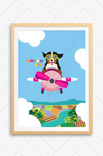 Wall art poster of a dog flying a pink plane, through the clouds with farming land underneath. The words Dream Big are written in colourful type next to the dog.