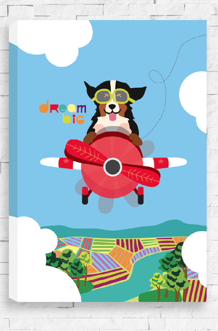 An illustration of a happy dog flying an older style red plane. Up high in the blue sky with a farming landscape below, the dare devil puppy is wearing goggles over it's eyes and it's ears flap behind him. The words Dream Big are written near it's body. This design is on a ready to hang canvas.
