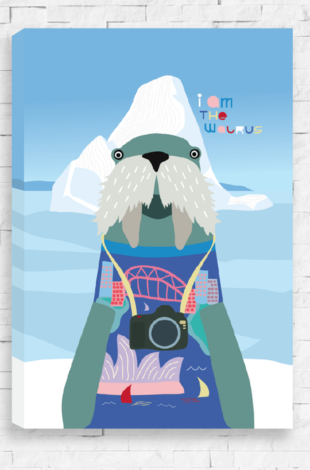 A hanging canvas with an illustration of a scene from Antarctica. Front and centre is a friendly looking walrus dressed in a blue jumper with the Sydney Harbour Bridge and Opera House knitted on it. Around it's neck is a camera and it poses like a tourist in front of an iceberg. The background is blue and has the word 'I Am The Walrus' written in colorful writing.