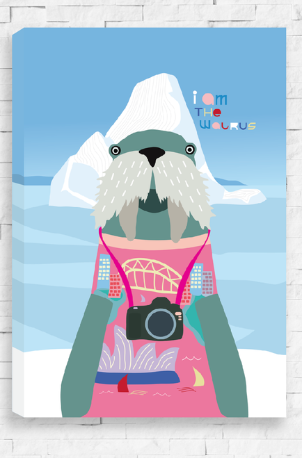 A hanging canvas with an illustration of a walrus dressed up as a tourist with a camera around it's neck. It is standing in front of an iceberg and is wearing a pink jumper with the Sydney Opera House and Habour Bridge on it. The words 'I Am The Walrus' are written in a playful font on the blue sky background.