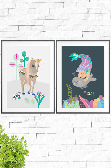 A two pack of prints, one Unicorn Magic with a light grey background, and the other Mermaid love with a charcoal background. The first print uses pastel tones contrasting with vibrant magenta and aqua. it features a beige colored unicorn with coral colored hair and a decorated bridal. The other a rosey cheeked seal swimming with his beautiful mermaid friend.