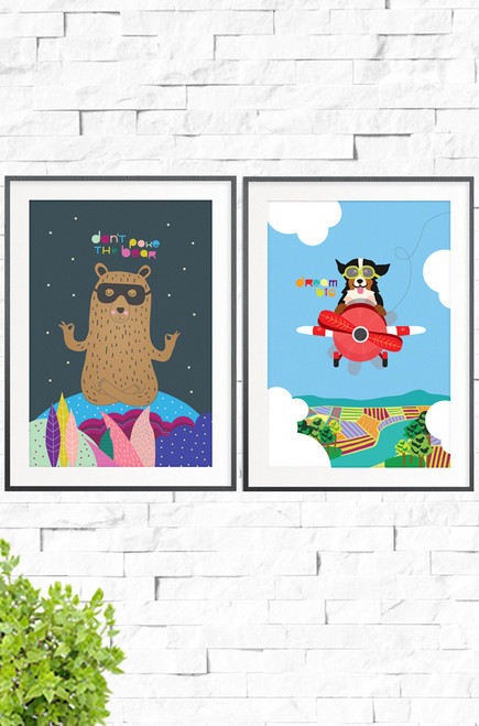 A bold duo of posters for a kids bedroom, Don't Poke The Bear and Dream Big. One is a brown bear, meditating on a colorful hill, adorned with a mysterious mask. The words Don't Poke The Bear written above him, on the dark charcoal background. The second print shows an ecstatic puppy, zooming through the blue sky on an old red plane. Below is a colorful landscape with a river and farming crops.