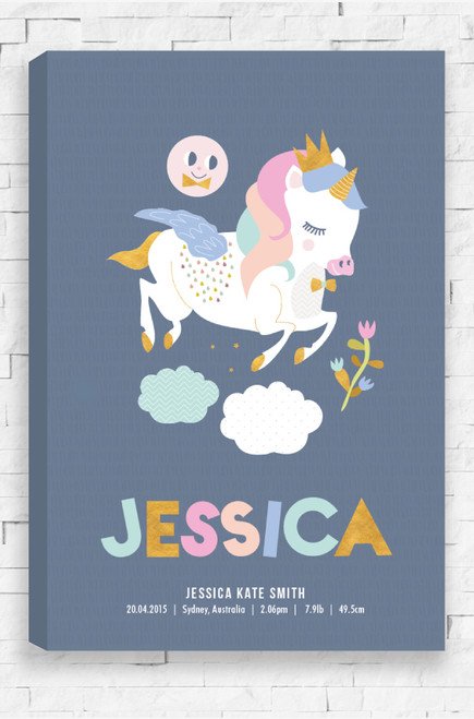 A ready to hang wall art canvas for a new born baby girl or boy. The illustration features a happy unicorn, jumping over patterned clouds. Overlooking the mystical creature is a happy moon or sun. The design features beautiful pastel colours with gold highlights and a pale charcoal blue background. At the bottom is personalised details of your loved one, their first name in a large, child friendly font in a variety of colours.