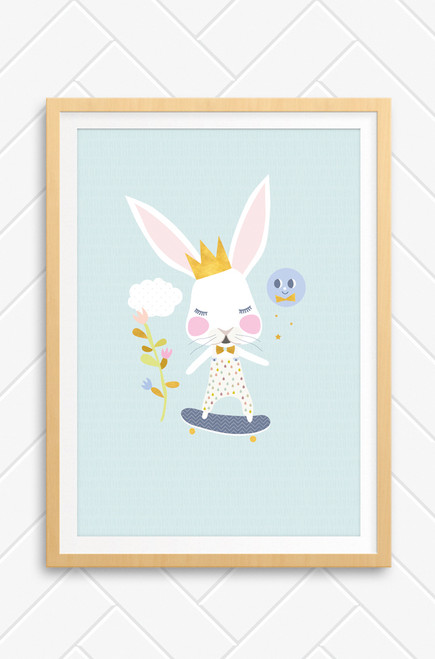 A wall art print with a white rabbit riding a skateboard. It wears a pair of overalls pattern with raindrops and a gold crown on it's head. Made in Australia and designed in country NSW.