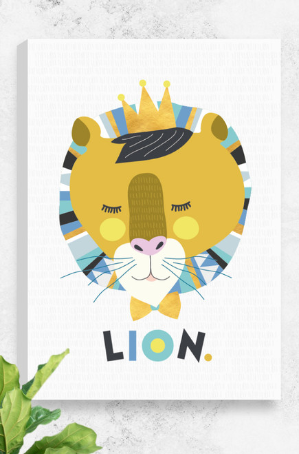 Leo Lion canvas by Luca Rose Designs, stretched and ready to hang. This artwork is Australian made and designed and features a lions head illustrated using vector graphics and blue and mustard colour combinations. The lion looks peaceful and wears a golden crown and bow tie. Underneath is the word LION written playfully, sitting on a light grey background peppered with a hand drawn stroke pattern.