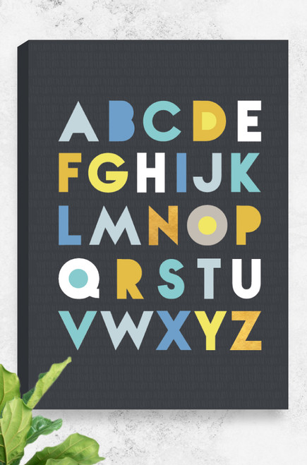 Set on a stormy charcoal background, this educational artwork, named 'Alphabet' comprises of all the letters arranged in 5 lines across the canvas. Each letter pops from the background in a range of blues, yellows and stunning gold. The type is modern and simple.