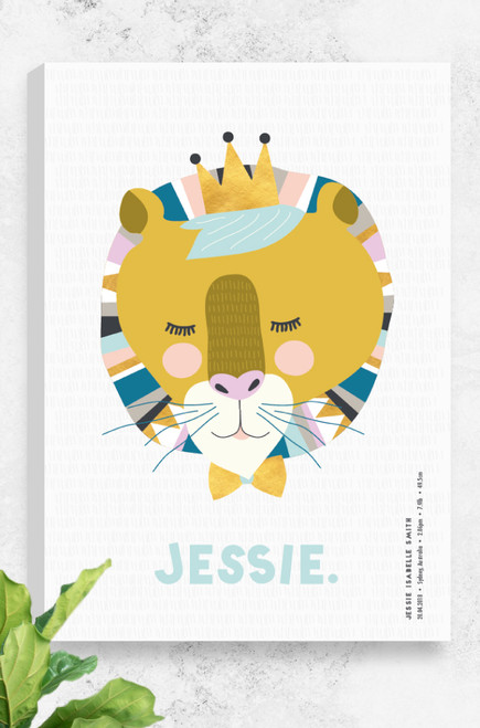 Luca Rose Designs personalised birth canvas featuring 'Lenni Lion', a friendly looking lion head wearing a golden crown and bow tie. The lion is created with mustard and pastel feminine colour combinations, sitting on a light grey background. Underneath the lion is letters spelling out the child's name, and arranged vertically in the bottom right corner are the birth details in a modern font.