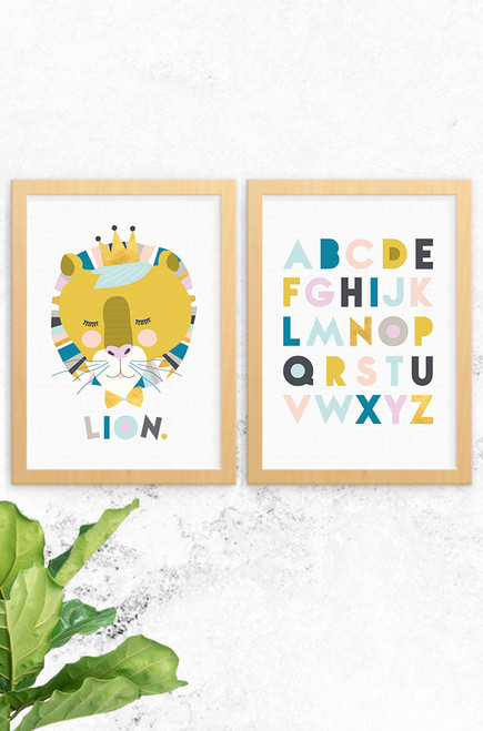 Luca Rose Designs 2 pack print set showing Lenni Lion print on the left and the Alphabet print on the right. Both have an oak frame and light grey background. The colour combinations are pastel, mustard and gold.
