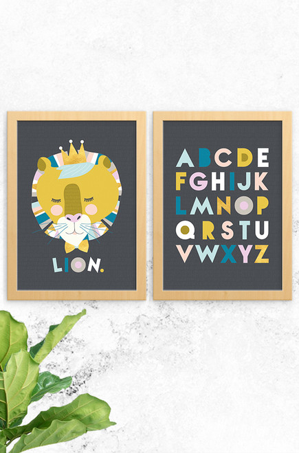 An image showing a Luca Rose Designs 2 pack prints, with Lenni Lion on the left and Alphabet on the right. Each poster as a charcoal background and uses a matching colour palette of feminine pastels, bright blue and gold hues. The font used is simple and fun.