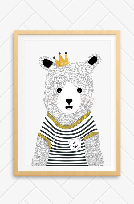 Noah Bear illustrated by Luca Rose Designs and set in a oak finish frame on a concrete background. The wall art print features a hand illustrated bear with detailed fur. he wears a black and white striped t-shirt with an anchor embellishment on the pocket and gold trims. On his head, tilted to the left is a small crown with black jewels on top. Australian designs and printed.