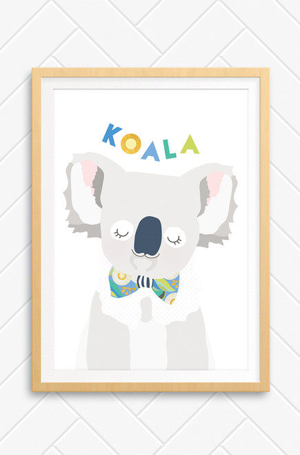 A simple illustration of a koala perfect for the walls of a nursery or kids bedroom. Digitally drawn in soft pastel colours, a peaceful look on his  face and a bright and patterned bowtie around his neck. Set on a fresh white background and framed in a modern oak frame.