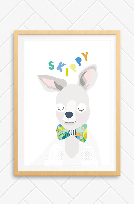 A happy illustration featuring a kangaroo wearing a bright patterned bowtie. Pastel colours contrasting with colourful greens and yellows. Set on a fresh white  background and an oak frame.