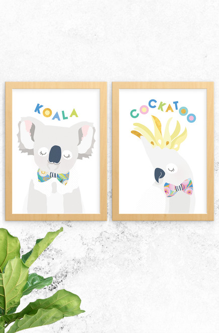 A 2-pack of prints featuring a gorgeous Australian koala and cockatoo. Both are digitally illustrated in pastel colours, with a bright and patterned floral bowtie. Each have the name of the animal written at the top in a fun typeface arranged playfully. Also available a budgie and a kangaroo named skippy, why not complete the wildlife collection!