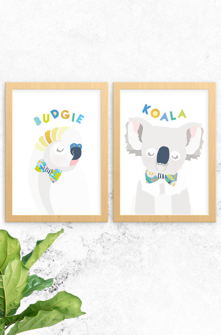 A 2-pack of prints featuring a budgie and precious Australian koala. Both are digitally illustrated in pastel colours, with a bright and patterned floral bowtie. Each have the name of the animal written at the top in a fun typeface arranged playfully. Also available a kangaroo named skippy and cockatoo, why not complete the wildlife collection!