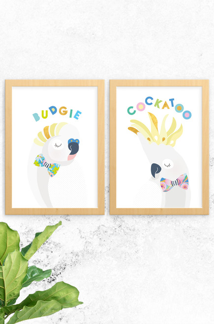 A 2-pack of prints featuring a budgie and cockatoo. Both are digitally illustrated in pastel colours, with a bright and patterned floral bowtie. Each have the name of the animal written at the top in a fun typeface arranged playfully. Also available a koala and skippy, why not complete the wildlife collection!