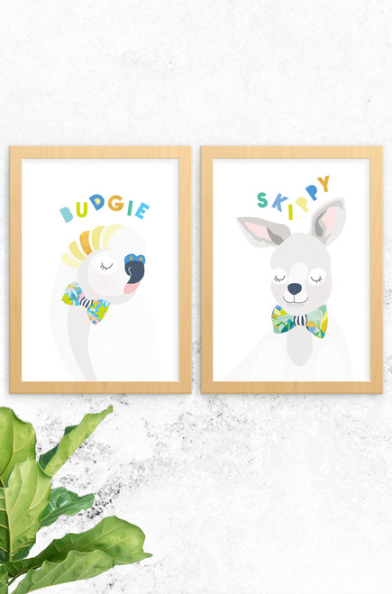 A 2-pack of prints featuring a budgie and kangaroo named skippy. Both are digitally illustrated in pastel colours, with a bright and patterned floral bowtie. Each have the name of the animal written at the top in a fun typeface arranged playfully. Also available a koala and cockatoo, why not complete the wildlife collection!
