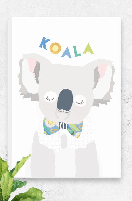 A cute and snuggly ready to hang canvas for kids featuring a delightful koala wearing a bowtie. Made up of light greys, yellows and greens, the illustration is set on a fresh white background. Also available in skippy, koala and cockatoo, the perfect set for any wildlife warrior.