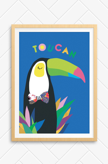 A brightly coloured illustration of a black and white toucan with a colourful beak. The bird sleeps peacefully with coloured leaves poking below him. Set on a bright blue background the word toucan is playfully arranged above the bird.