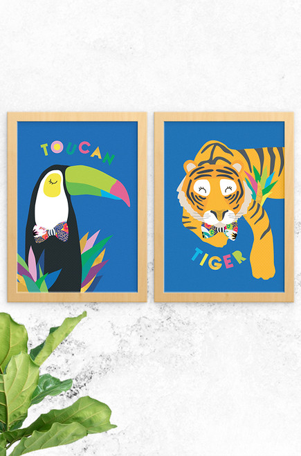The perfect pair of prints, a toucan and tiger illustrated in a modern simplistic style. Both vibrant in colour, wearing a bowtie around each neck and set on a bright blue background.