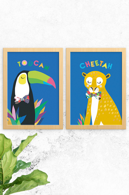 A stylish pair of artwork for children featuring a happy toucan and sleepy cheetah, both wearing a floral oversized bowtie. Team up with our other jungle fever prints to complete the collection.