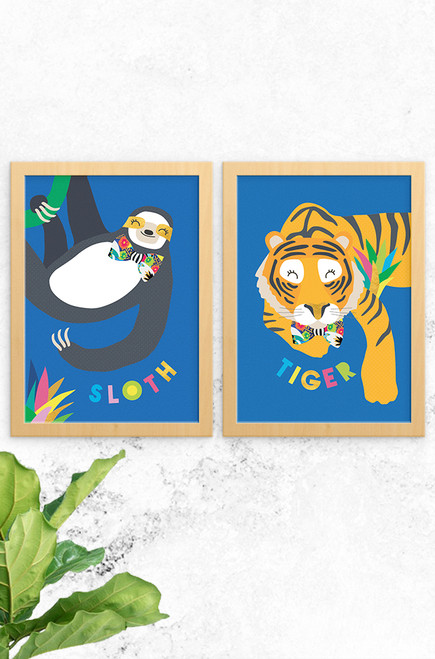 A stylish set of prints ready to decorate a jungle safari themed room. Digitally illustrated, one print features a sloth, the other a sleepy tiger. Both wearing a floral bowtie and placed on a vibrant blue background.