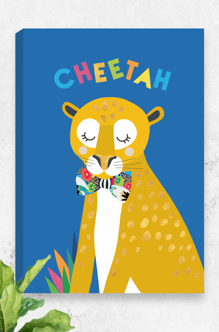 A ready to hang canvas of a cheetah wearing a giant floral bowtie. It's eyes are closed and it has a peaceful demeanour. The bright oranges of the big cats body, contrast with it's shiny golden spots and bright blue background. The word cheetah is playful arranged above it's head in a colourful font.