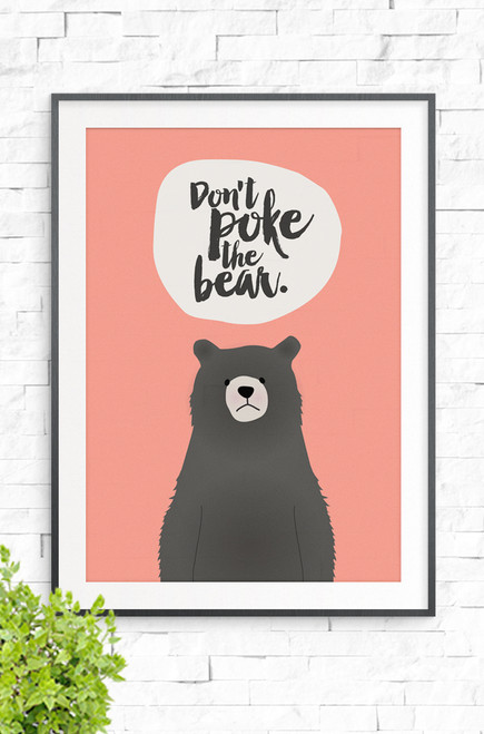 With an apricot background, this wall art print features a beige bubble at the top with the words 'Don't Poke The Bear' written in a brush style font. Underneath is a brown bear with an unhappy look on it's face.