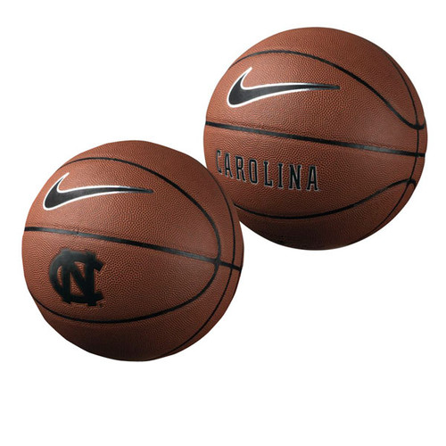 A brown leather basketball with a black embossed interlocking NC on one side and the word Carolina on the other.  The Nike swoosh makes an appearance too.