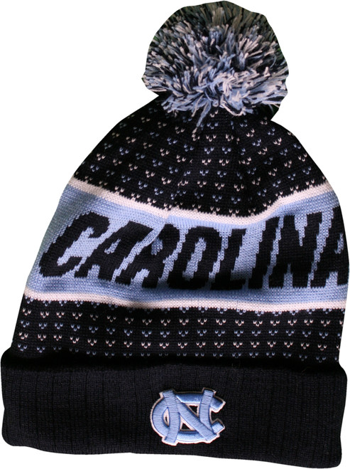 Mostly navy toboggan with a pom on top.  Broad Carolina Blue stripe has Carolina stitched in it.