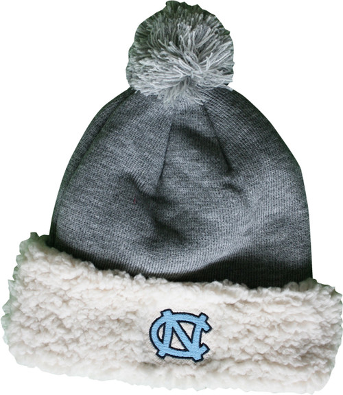 Cuff is fuzzy sherpa and top is tightknit gray.  Embroidered NC on the cuff and a pom pom on top.