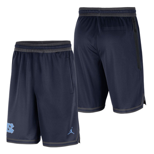 Carolina shorts that are navy with an interlocking NC on the lower right leg and a Jumpman on the left leg.