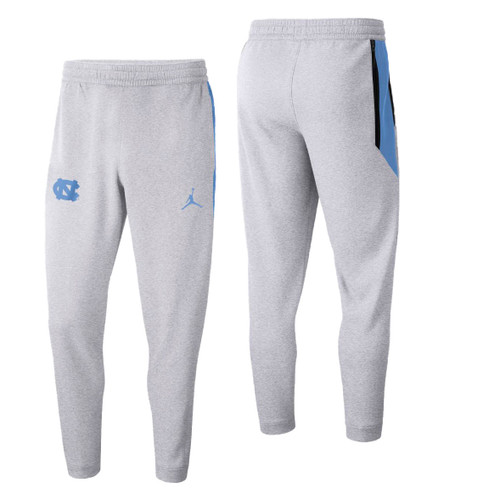 Carolina sweatpants that are a light heathered gray with an interlocking NC on the right upper thigh and a color swatch of Carolina Blue trimmed in navy on the upper right side thigh.