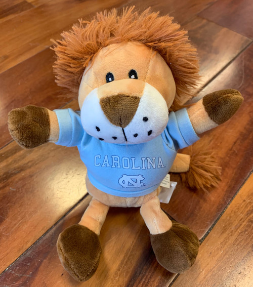 stuffed lion wearing  Carolina tee shirt