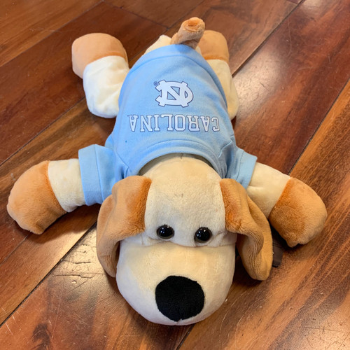 stuffed floppy puppy wearing a Carolina tee shirt