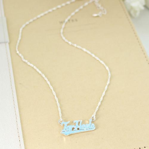 Script Tar Heels enamel Carolina Blue on a silver necklace.