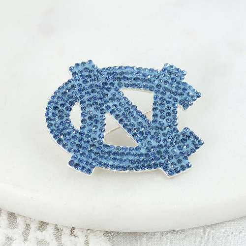 Interlocking NC pin made from Carolina Blue rhinestones.