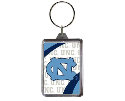 Carolina key chain that is a lucite square with an interlocking NC and repeating letters UNC.
