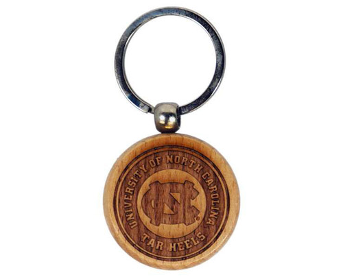 Carolina key chain that is a round piece of bamboo with University of North Carolina Tar Heels and an interlocking NC etched into it.