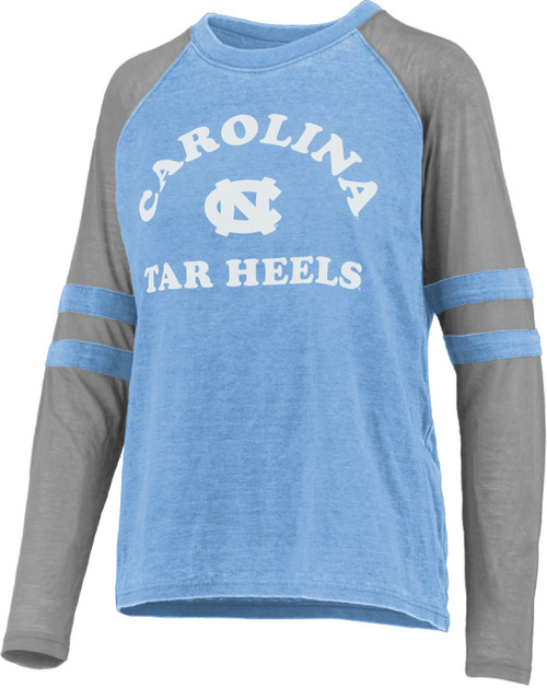 Vintage washed raglan sleeve tee shirt.  Body is Carolina Blue and the sleeves are gray with sewn on sleeve stripes.  Decoration is arc Carolina over an interlocking NC over Tar Heels.
