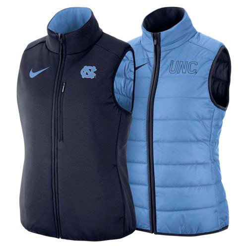 Women's down reversible vest.  One side is navy with an interlocking NC left chest.  Other side is Carolina Blue with an UNC on the left chest.